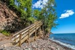 Enjoy 600 feet of Lake Superior cobblestone shoreline. Note: The staircase is now metal.